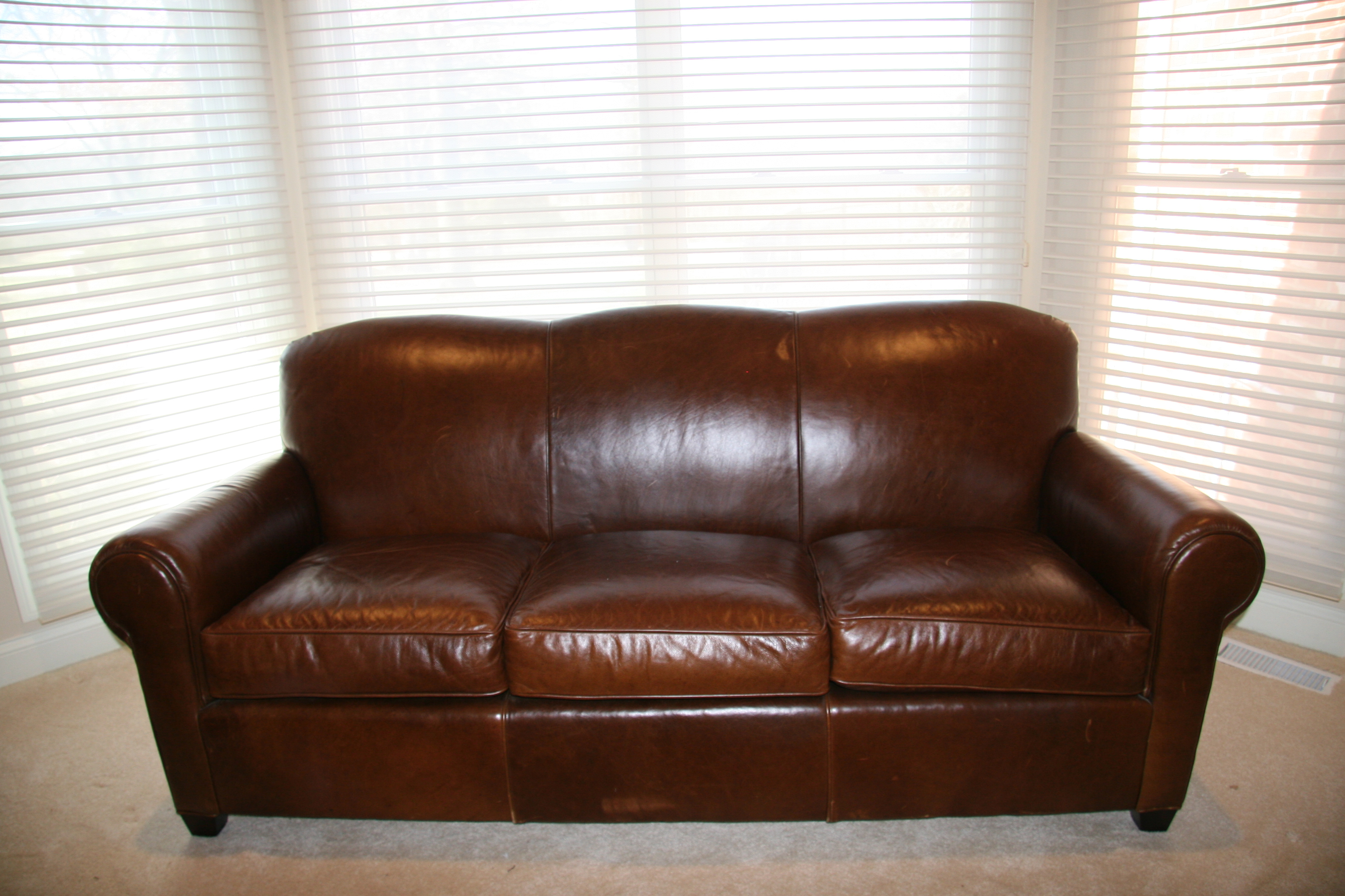 crate barrel brown leather sofa